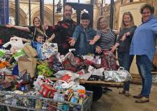 Oliver! musical audiences gift food bank's biggest ever donation