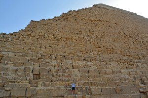 Scott Swiontek standing on one of the Pyramids fo Giza, Cairo, Egypt.