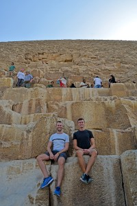 Scott Swiontek and John Line sitting on the Great Pyramid in Giza, Cairo, Egypt.