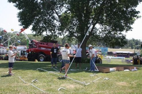 Volunteers helping set up prior to fair.