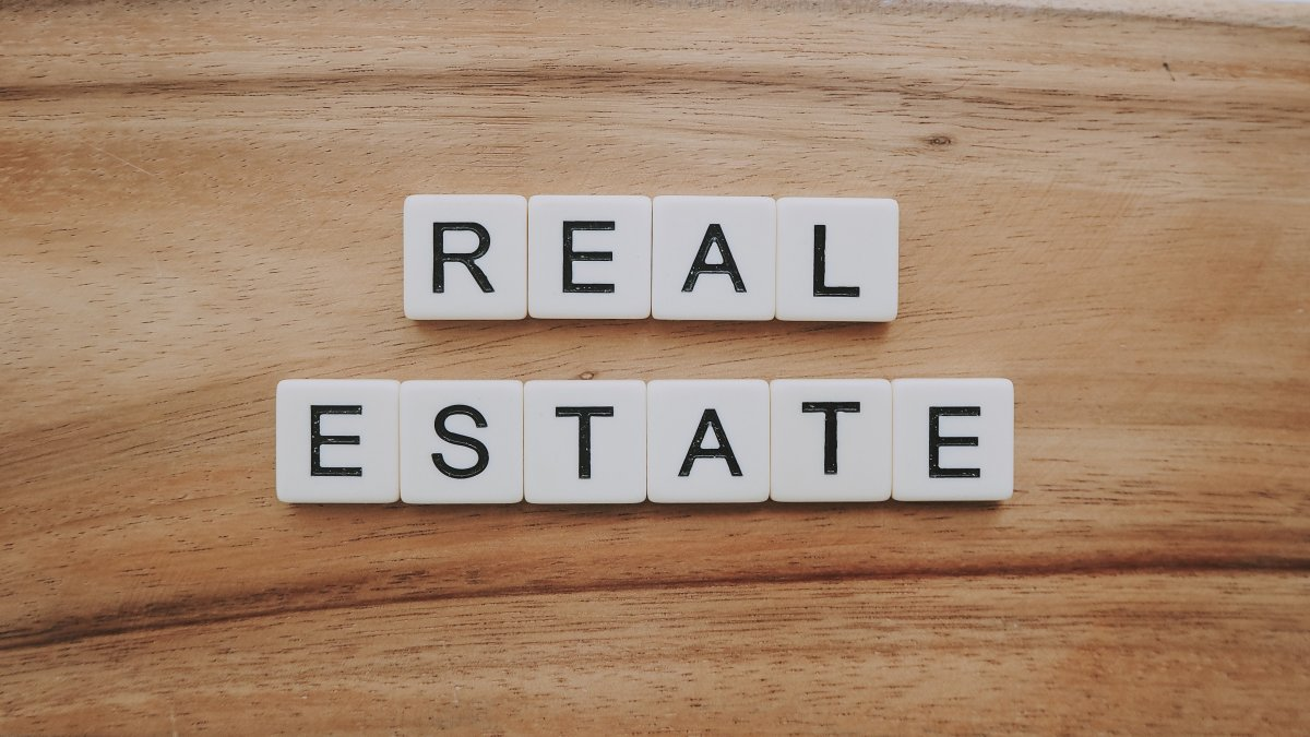 Real Estate Funding, Real estate spelled out in scrabble pieces.