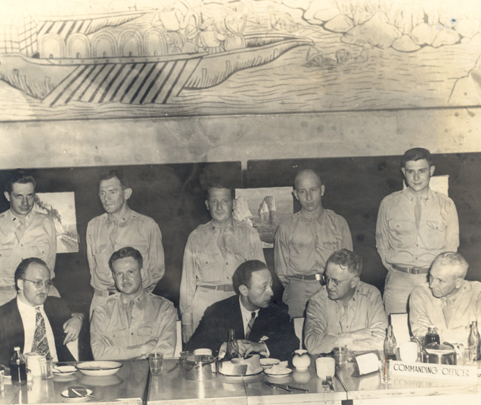 Jascha Heifetz and his accompanist, Milton Kaye, having dinner with troops from the 21st General Hospital following a USO concert in Naples, Italy, June 16,1944.