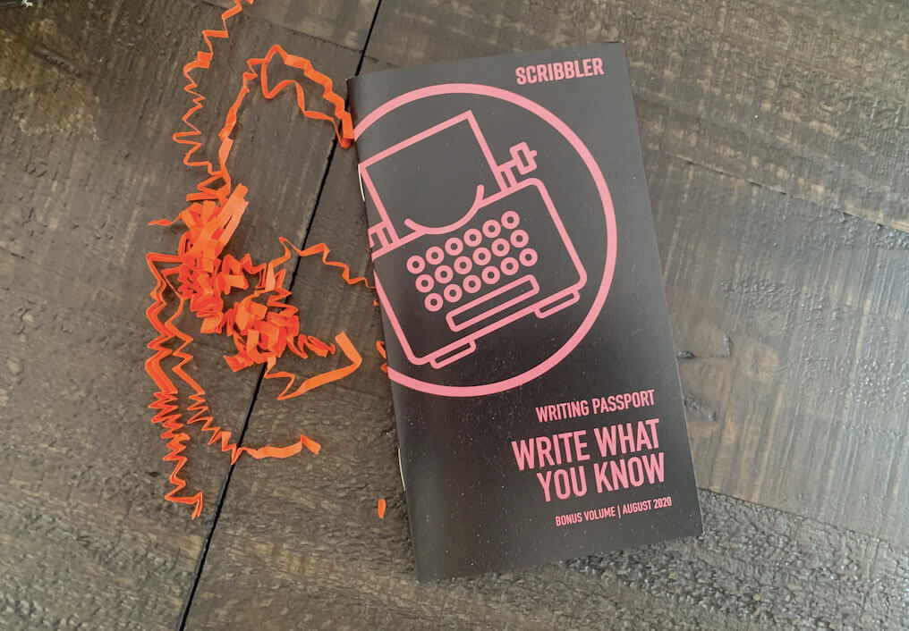Black and Pink Scribbler Booklet on Write What You Know on Table