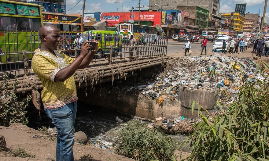 Cyprian Ogoti, a leading activist, takes photos of the Nairobi River. Photo: The Guardian