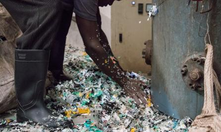 Worker at a recycling plant.