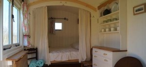 quirky accommodation with canopy and stars hollow-ash-herefordshire_woodland-hut-interior_cs_gallery_preview