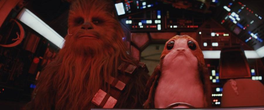 Chewbacca (Joonas Suotamo) and a Porg.