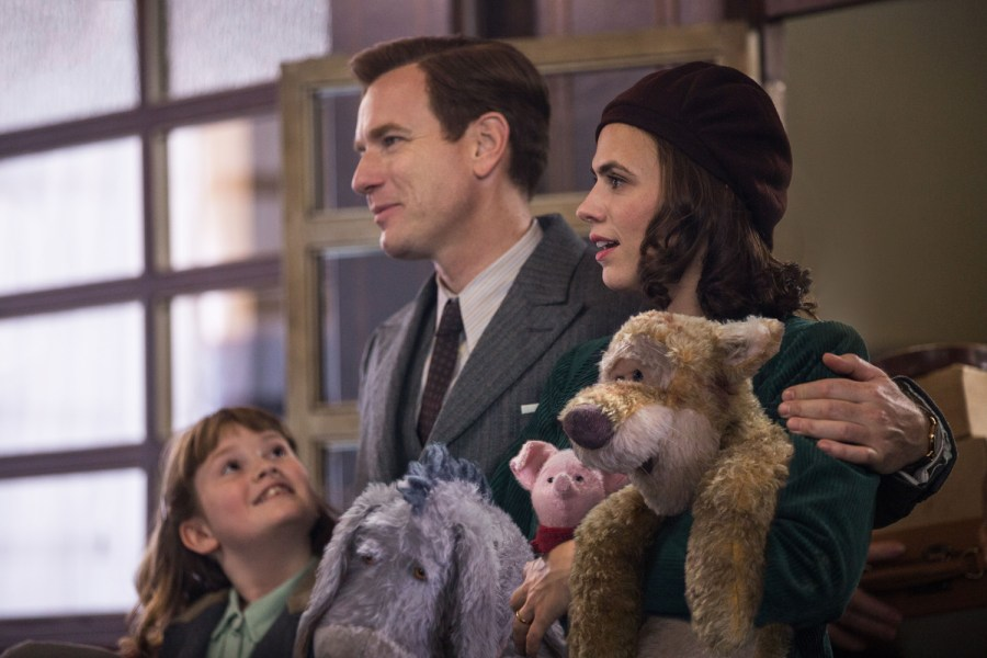 Madeline Robin (Bronte Carmichael), Christopher Robin (Ewan McGregor), Evelyn Robin (Hayley Atwell), Eeyore, Piglet and Tigger in Disney's live-action adventure CHRISTOPHER ROBIN. | Credit: Walt Disney Studios