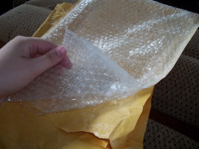 Peel the outside packaging from a bubble wrap packaging envelope and use the bubble wrap to store fragile Christmas decorations!  from thelittledabbler.com