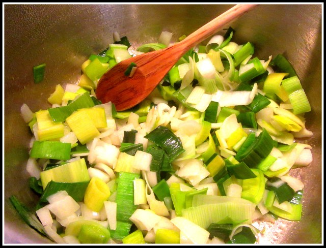 Leek and onion cooking in pot