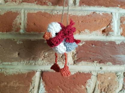 Knitted baby seagull with scarf