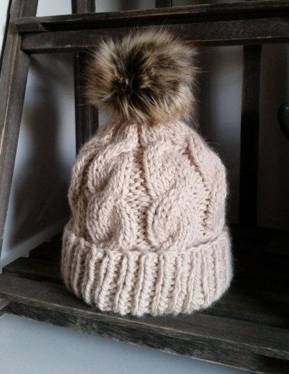 cable hat with faux fur pompom