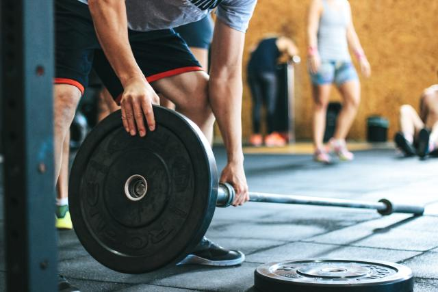Wipe down equipment to stay safe in the gym