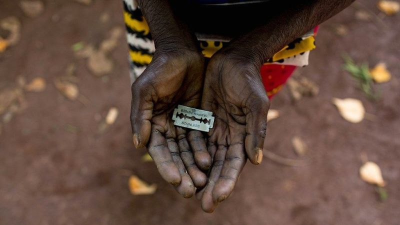 This woman in Mombasa, Kenya shows the razorblade she has used on girls' genitals, via BBC