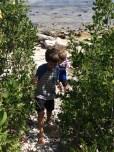 sand, stones & sun. A little boys paradise