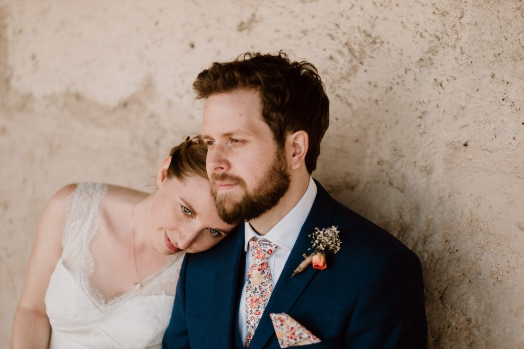 Bride and groom. groom wearing liberty print tie and pocket square