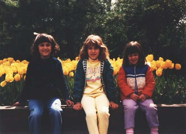 Jessica in the middle with gap teeth and a yellow sweatsuit! Christina on the right with an orange coat, purple sweat pants and a scrunched-up face. ...And Vanessa on the left looking perfect, topped with a bow.