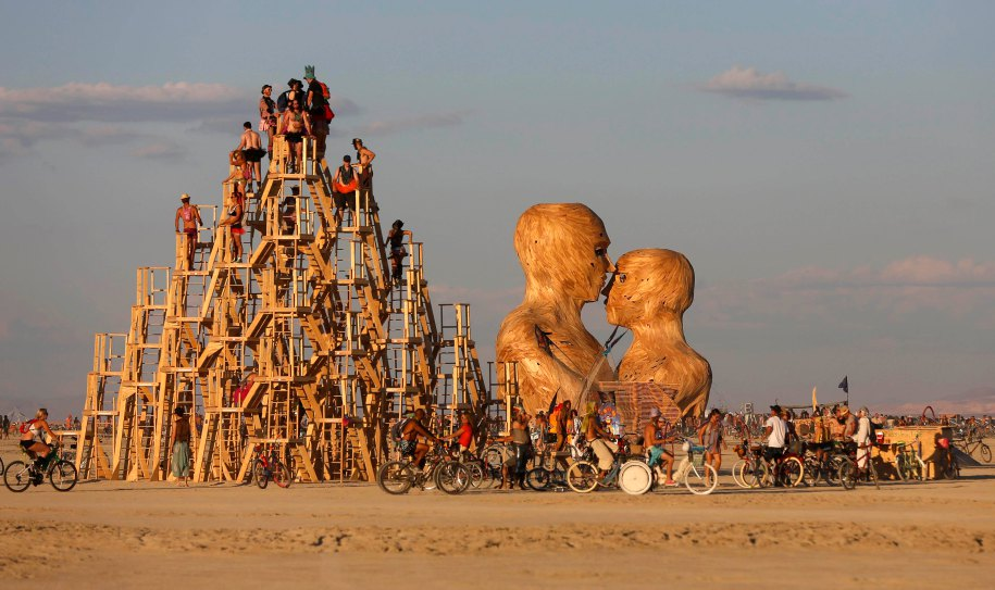 "People interact with art installations during the Burning Man 2014 ""Caravansary"" arts and music festival in the Black Rock Desert of Nevada August 26, 2014. People from all over the world have gathered at the sold out festival to spend a week in the remote desert cut off from much of the outside world to experience art, music and the unique community that develops. Picture taken  August 26, 2014. REUTERS/Jim Urquhart (UNITED STATES - Tags: SOCIETY) FOR USE WITH BURNING MAN RELATED REPORTING ONLY. FOR EDITORIAL USE ONLY. NOT FOR SALE FOR MARKETING OR ADVERTISING CAMPAIGNS. NO THIRD PARTY SALES. NOT FOR USE BY REUTERS THIRD PARTY DISTRIBUTORS"