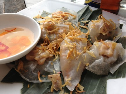 White rose dumplings ( Banh bao vac), made from translucent white dough which is filled with spiced minced shrimp and pork, at Morning Glory in Hoi sn, Vietnam