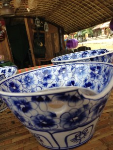 Local Hoi an beer served in those beautiful and handy bowls, in the boat on Hoai River in Hoi an, Vietnam