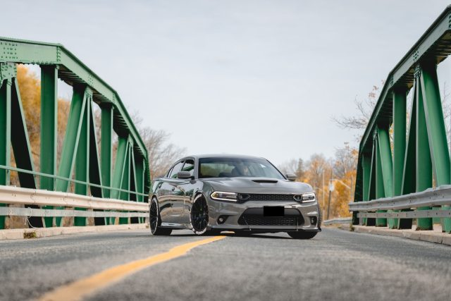 The Best Mortgage Advice I've Ever Given - Don't Buy That Car! A grey Dodge Charger parked on an angle on a bridge