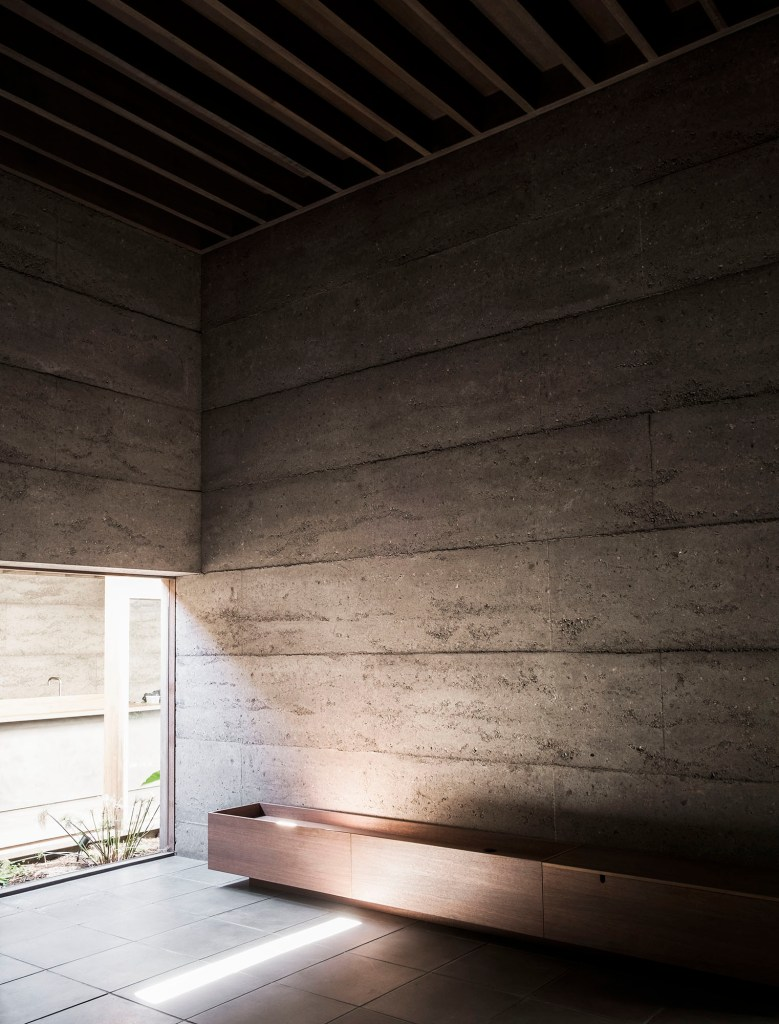 Rammed Concrete Walls Are Unadorned With Further Embellishment
