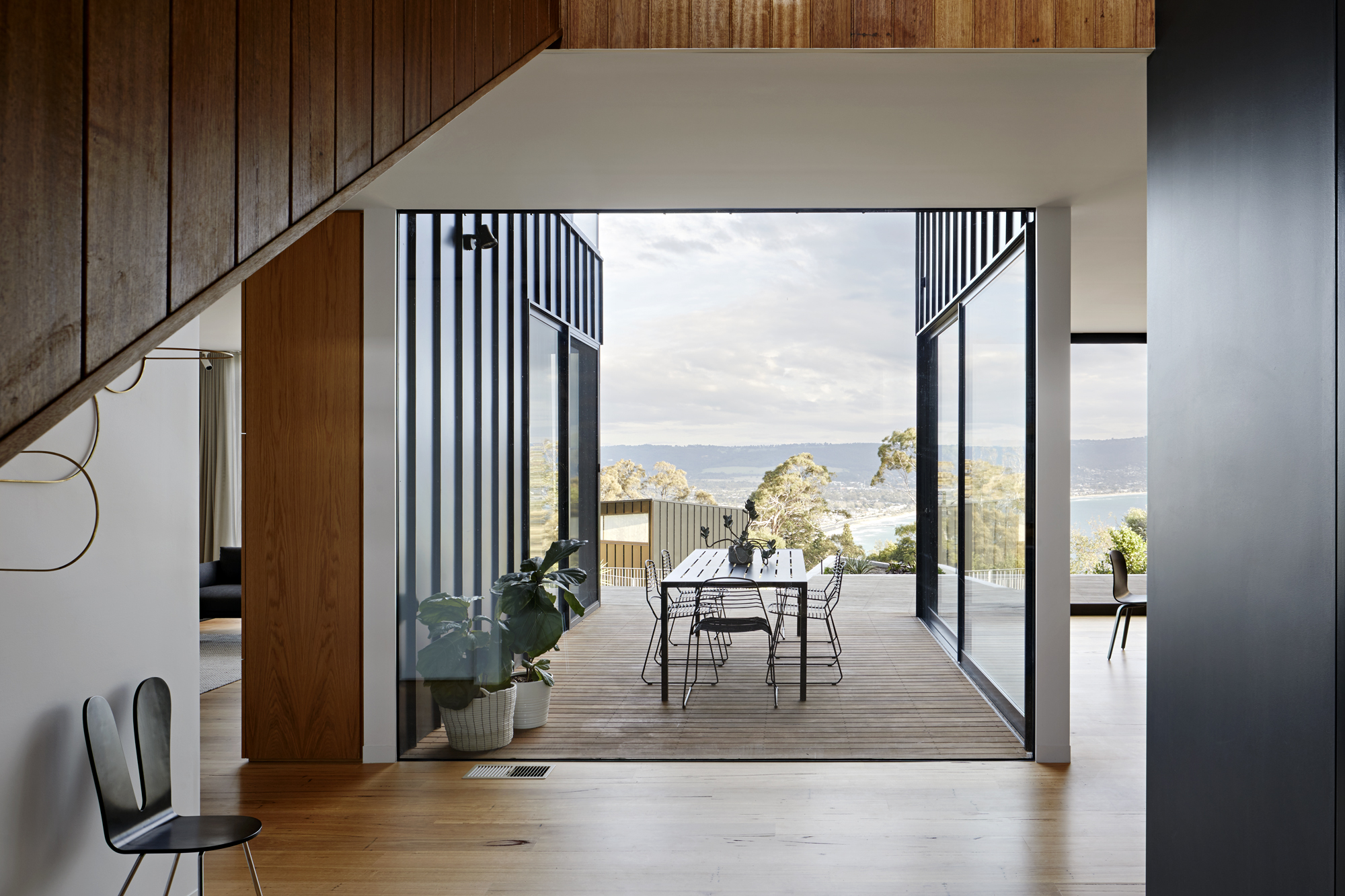 The Impressive Double Height Circulation Space Connects The Levels And The Front And Back Of The Property.