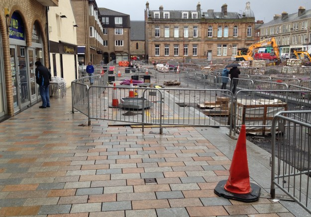 The work has caused some disruption but the council says it has been planned in such a way that people will be able to walk round the square on the new paving while work continues towards the centre.