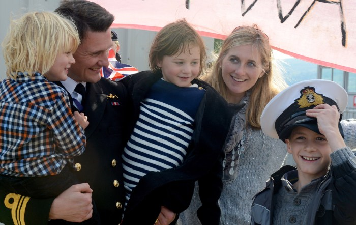 Lt Cdr Rory McEwan greets his delighted family after spending the last eight months on board HMS Astute