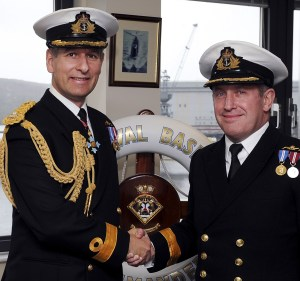 Commodore Keith Beckett welcomes Commodore Mark Adams (right) to Faslane