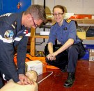 Lizzie Ashley watches as a French medic treats 'Fred', one of the lifesize mannequins used during the exercise