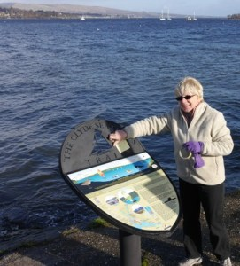 A new look: Anne Urquhart of Love Loch Lomond installing one of the new panels.