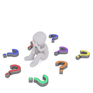 image of person surrounded by question makrs
