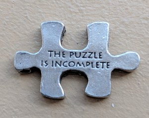 puzzle piece with message The Puzzle is Incomplete