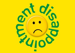 unhappy face with the word disappointment