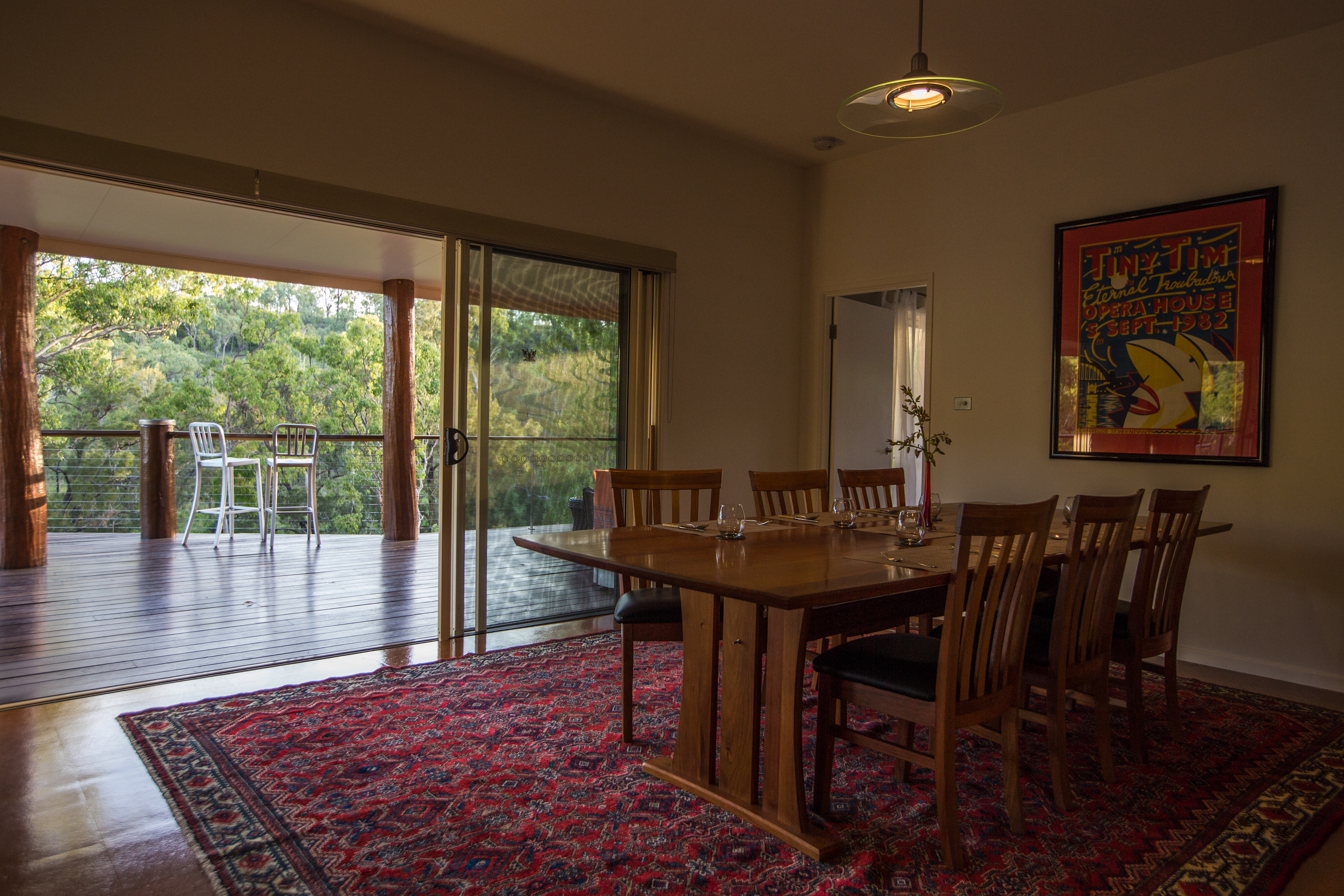 Huge dining table leading to river view deck The Long Weekend Retreat Millstream