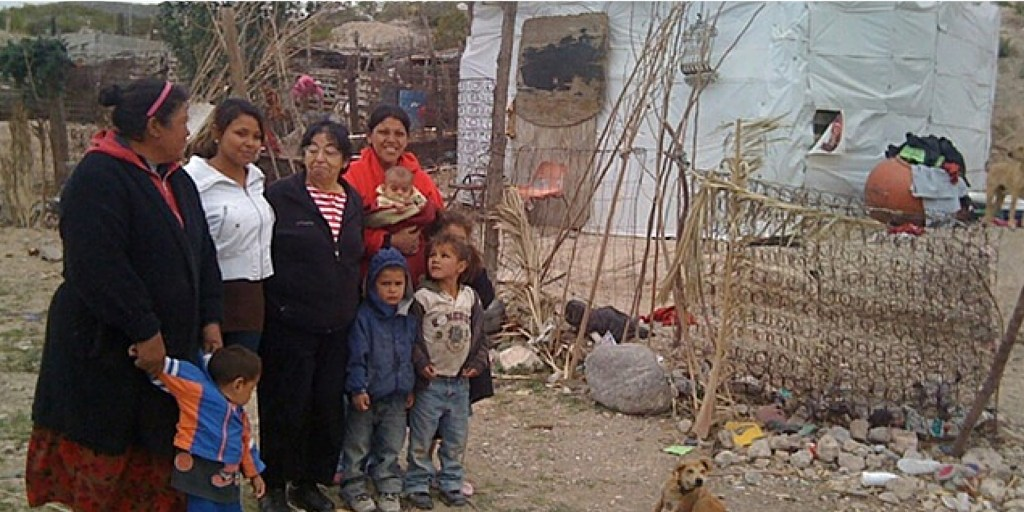 Ministering to a poor family in Juarez, Mexico.