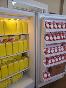 Refrigerated cartons of liquid eggs and containers of yogurt.