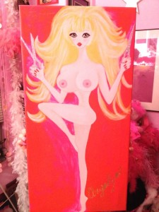 One of Angelyne's paintings. The scissors are done in silver glitter paint. (Photo by Nikki Kreuzer)
