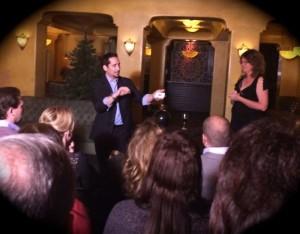 Magician David Minkin performs a card trick with an audience volunteer (photo by Nikki Kreuzer)