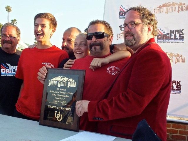 Smokin Mo's Trophy winning team receiving trophy from Ben Lobenstein. Photo by Ed Simon for The Los Angeles Beat.