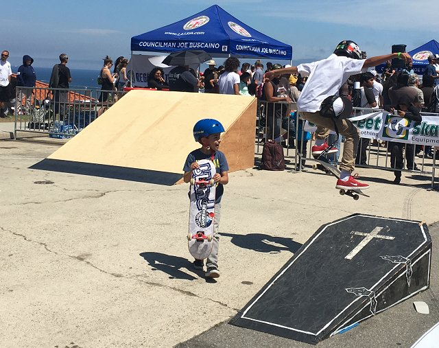 Grommets attack the mini ramp park. (photo by John Collinson)