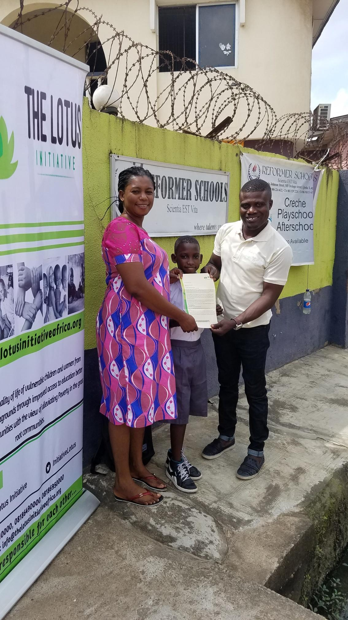 Lotus Initiative Program Manager with Master Samuel Adams with his Mother.
