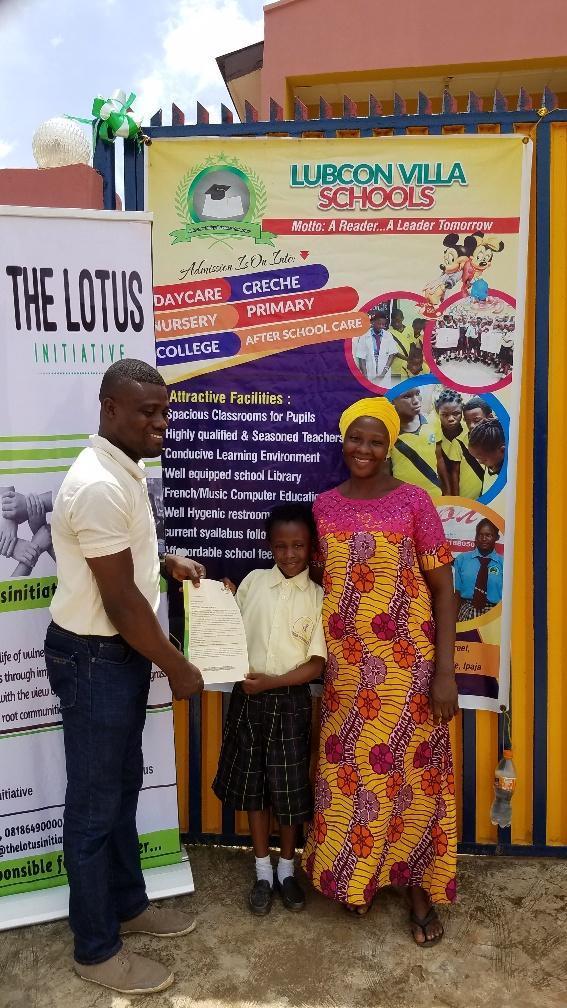 Presentation of scholarship letter to Imoleayo Alaka with his mum.