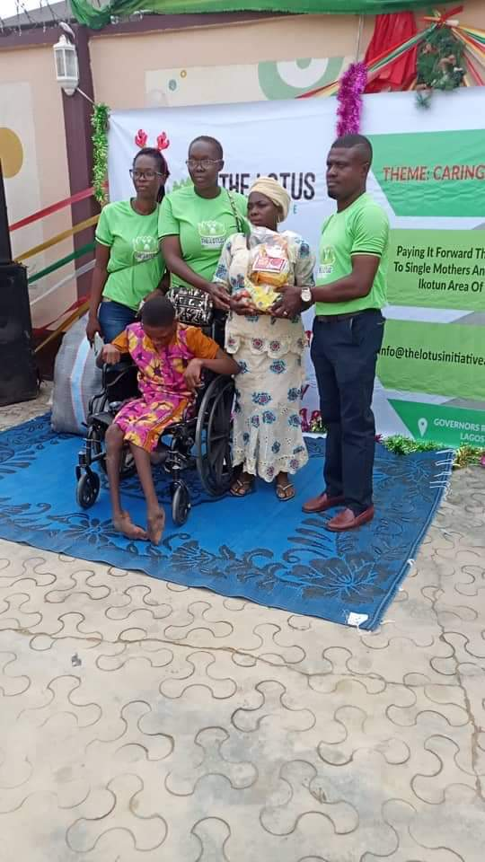 Presentation of wheel chair to the lame... Love and Compassion is all we do..