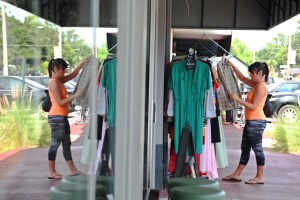 11. A shopper is reflected in the window of stores along Corrine Drive in Orlando's  Audubon Park Garden District.