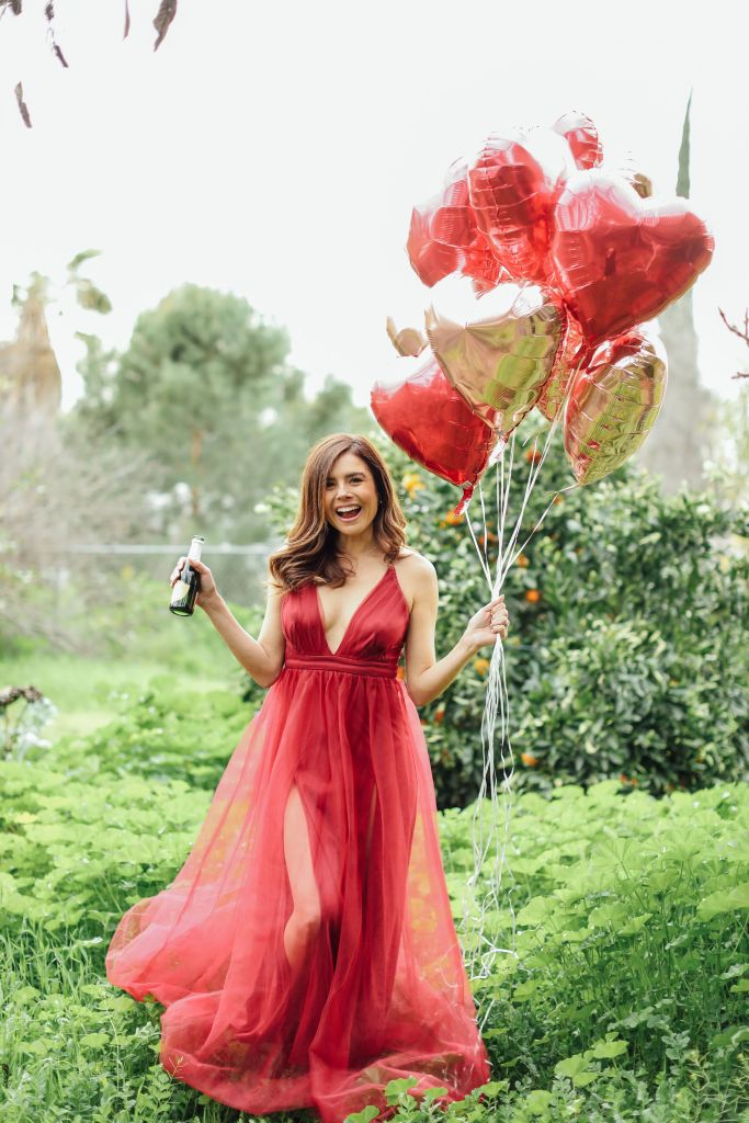 Burgundy tulle dress with heart balloons