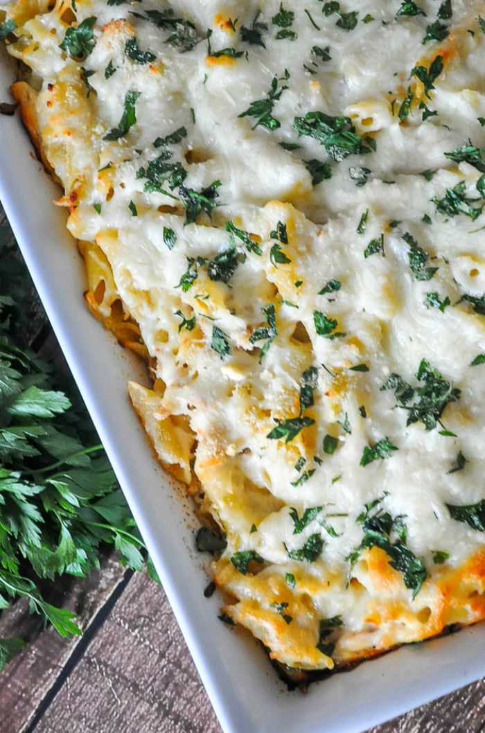 Creamy Chicken Alfredo Pasta Bake - A delicious casserole recipe the whole family will love. Made with a lighter homemade Alfredo Sauce. | The Love Nerds