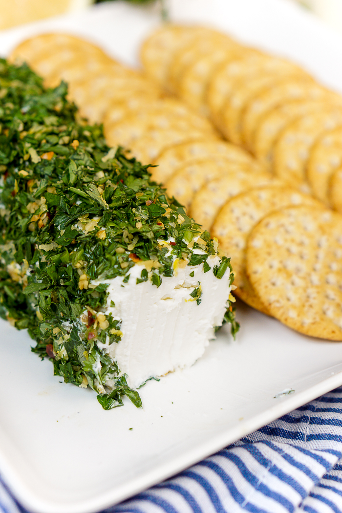 Lemon and Herb Goat Cheese Log - A light and refreshing appetizer that guests will love all year long! Plus, it's such an easy appetizer recipe to prep, it's a shame not to!   The Love Nerds