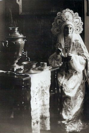 Ballerina Anna Pavlova in a Russian costume sitting at the tea-table c.1920